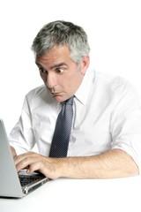 surprise gesture senior businessman work laptop