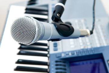 microphone and piano keyboard close-up