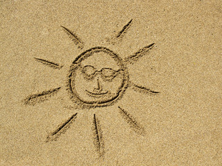 sun drawing on the sand