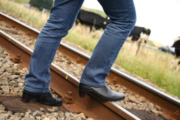 Boots on Railway Track