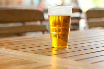 beer standing on a wooden table