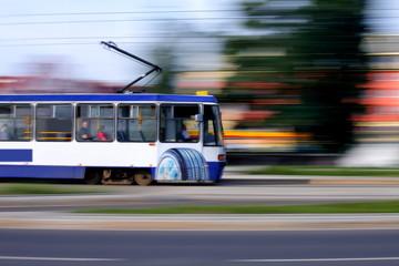 Blue tram rider fast on rails, Wroclaw, Poland