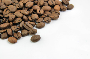 Coffee grains with cup close-up