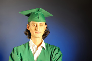portrait of a succesful man on his graduation day in green cloth