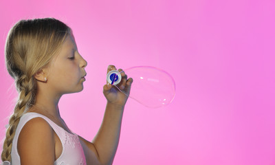 The pretty girl with soap bubbles