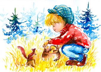 Boy feeds a squirrel