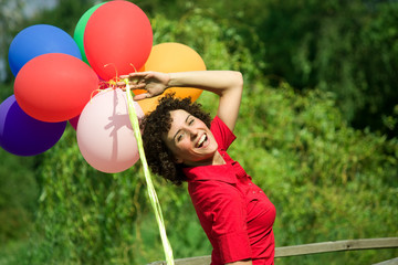 Beautiful young woman celebrate outdoor with balloons
