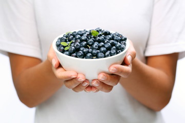 Crockery with blueberries.
