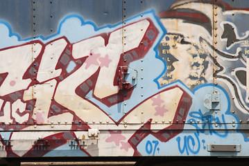 Graffiti on side of railroad car