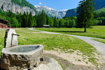 Water source at mountain hiking trail. Sixt Fer a Cheval