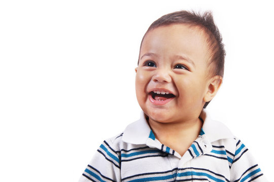 Cute baby smiling looking up