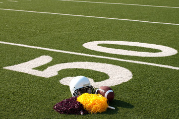 Wall Mural - American Football Equipment and Pom Poms on Field