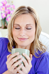 Attractive young woman enjoying her coffee