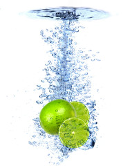 Fresh lime dropped into the water