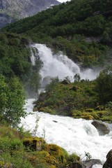 Moutain river with waterfall