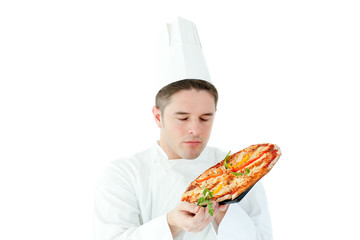 Caucasian male cook holding a pizza