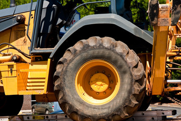 Giant Tractor Tire on Heavy Yellow Equipment