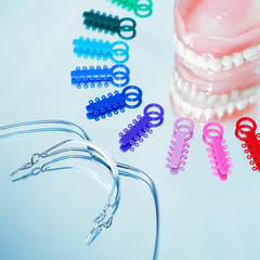 Multicolored ligature ties , prosthetic dentures and facebow
