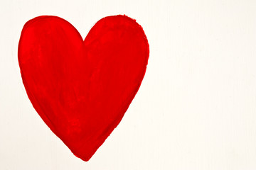 Red heart painted by hand on white wood plate
