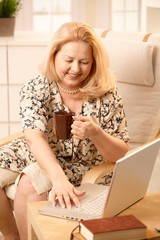 Senior woman with laptop