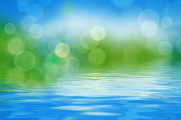 summer background with blurs and refelctions in water