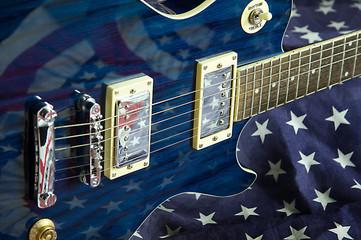 Blue Guitar on Flag Background