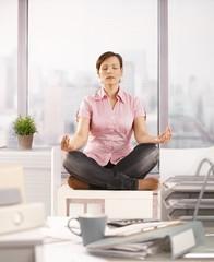 Office worker meditating
