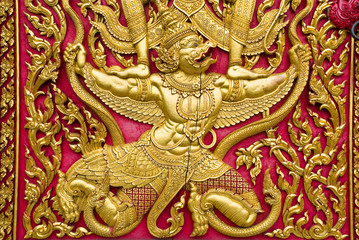 garuda carved gold paint on church door