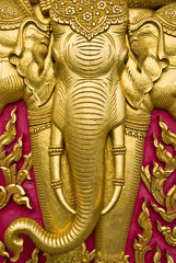 elephant carved gold paint on church door