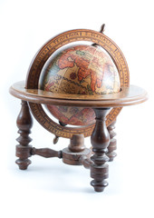 Old wooden globe showing Europe on isolated background.