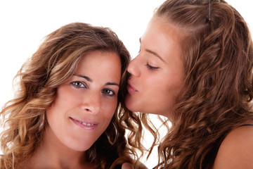 Happy daughter kissing mother