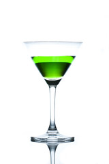 Green drinks in martini glass on white background