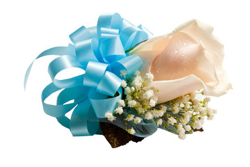 Corsage with blue ribbon, cream colored rose