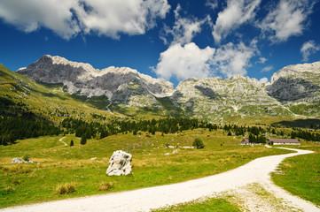 Mountain hiking trail in Montasio plateau, Sella Nevea, Italy