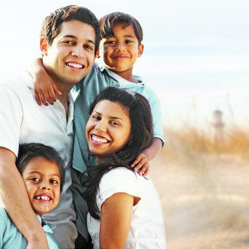 Happy family enjoying summer vacation portrait