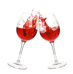 Red wine splash in two glasses