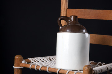 Old Pottery Jug on Rope Chair