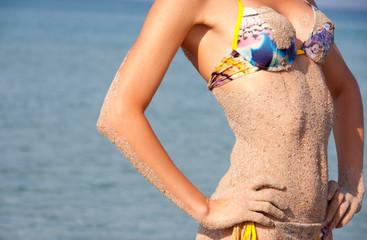 Heat, sea, sand and bikini woman
