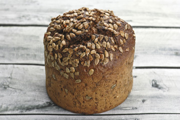 Wholegrain bread with sunflower seed on wooden table