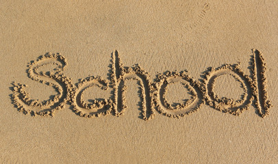 school written on sand
