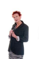 Older Woman with Red Hair Holding Lapels