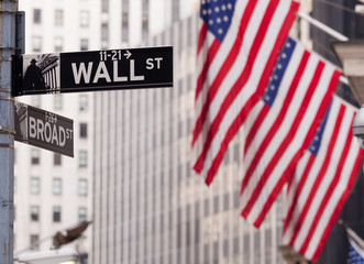 Wall Street road sign in the corner of New York Stock Exchange