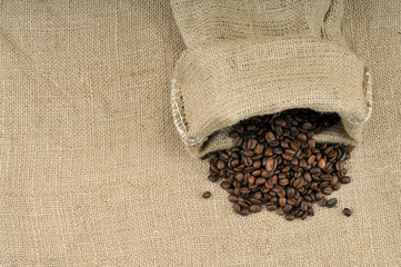 Burlap sack with coffee beans background with copy space.
