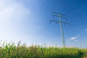 Electrical pylon over blue sky