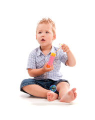 Small baby playing with soap bubbles