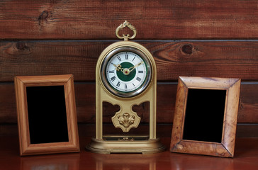 old photo frames and antique clock