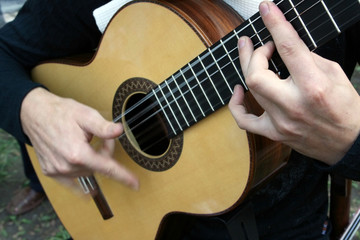 Man's hands plaing a guitar