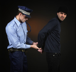 Police arrest _ officer and thief
