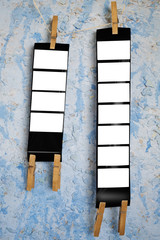 Wall Mural - Printed medium format film strips, against grungy background