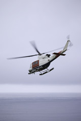 Rescue Helipocter flying over ocean